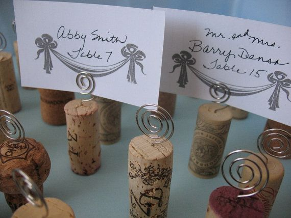 Wine cork and wire place card holders.  Great idea for displaying food names/descriptions at a wine and cheese party.