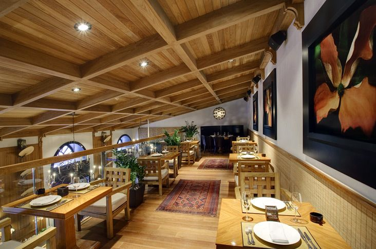 Various style of restaurant interior design wooden ceiling flooring and table set with black pictures frame on the white wall