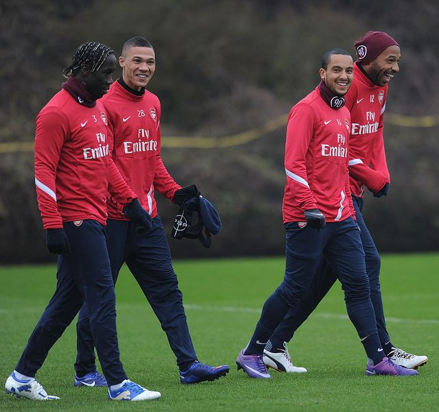 Arsenal players share a joke before training