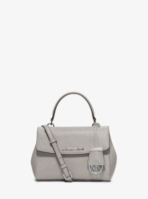 8f6cd921ae5e This compact crossbody is richly tactile and beautifully shaped in a  sophisticated silhouette. Timelessly understated with a touch of gilded  hardware