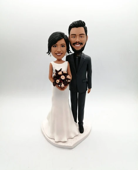 Photo of custom cake topper bobble head wedding bride and groom figurines decor