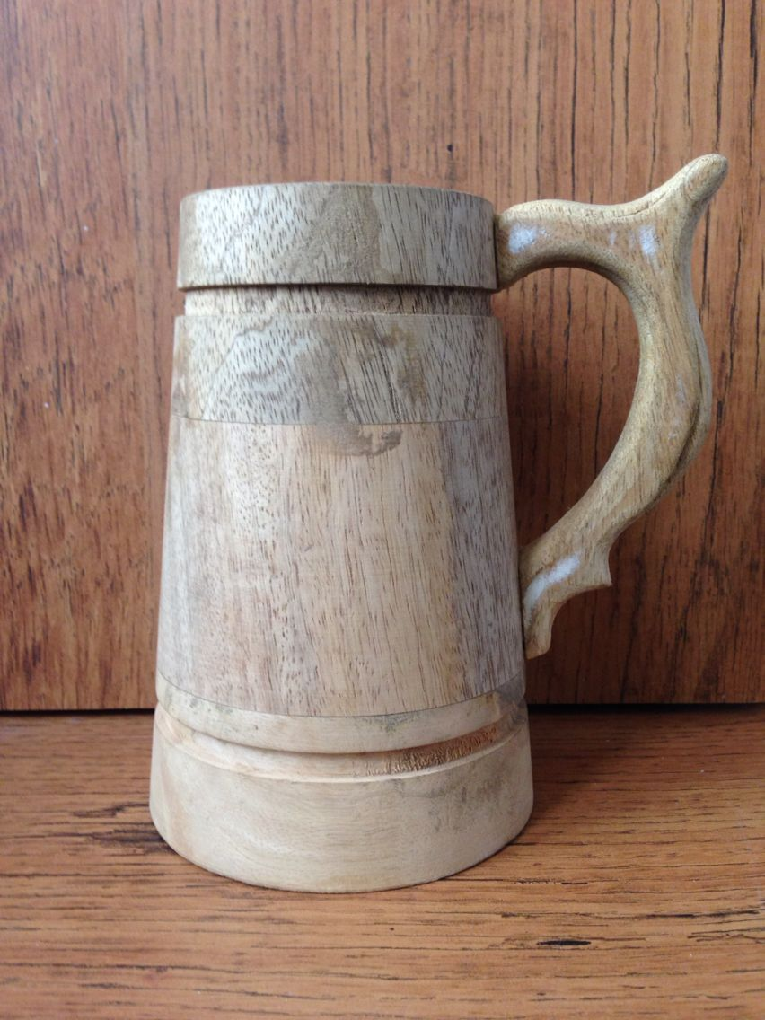 Rough without polished wooden mug. In mango wood.   USD $ 4.1  Info@paloverseas.com