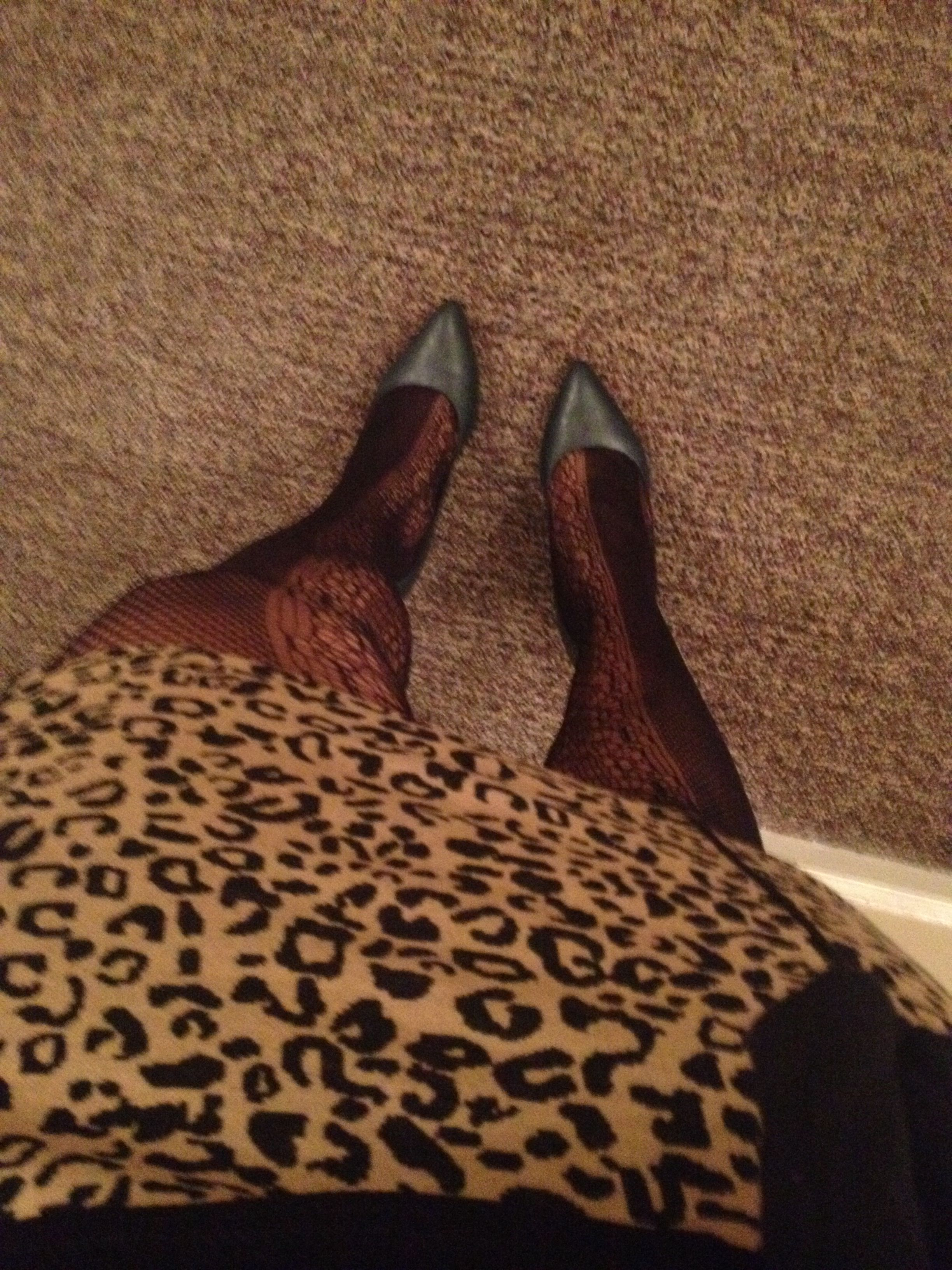 Cheetah print skirt, fish nets, and forest green pointy toe heels