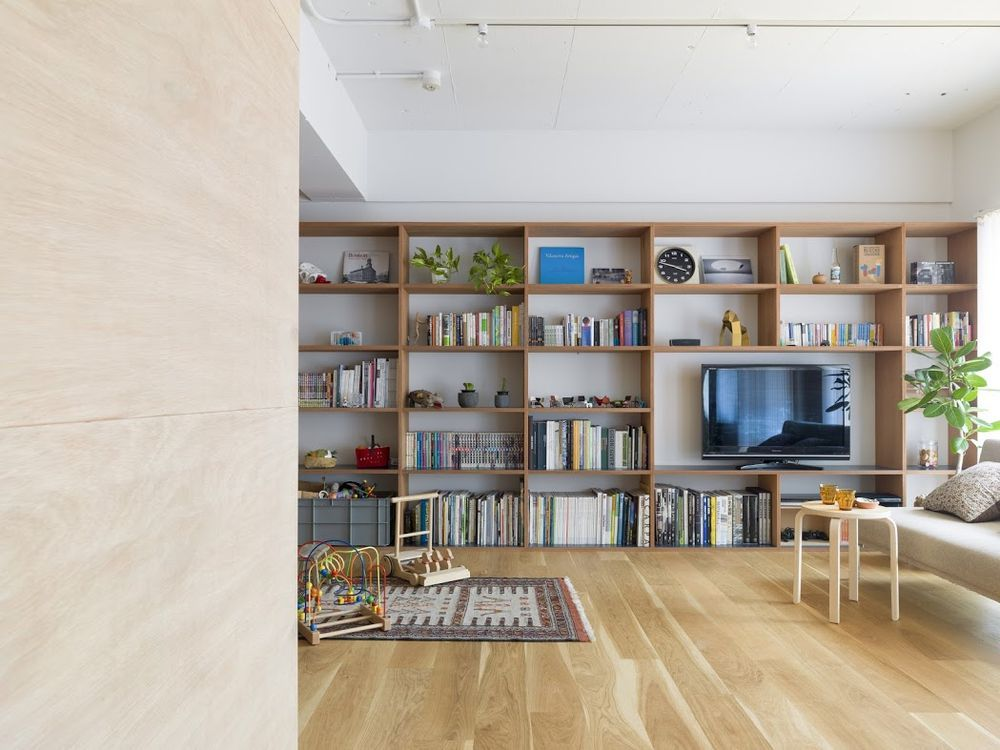 Tokyo apartment uses plywood to increase space and storage