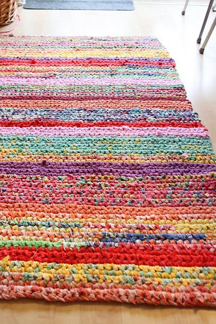 LEVEL 6 (probably best done in one of the forms of single crochet, or perhaps half-double crochet, which is introduced in level 13.5 in this set of projects, but could easily be learned earlier on) - - - crochet rug. - so well done!  Great use of color!