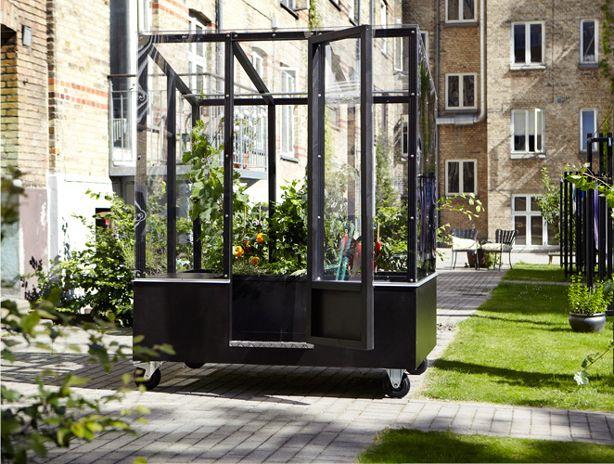 Stylish Urban Greenhouse On Wheels Urban Gardens Urban Garden Greenhouse Diy Greenhouse Plans