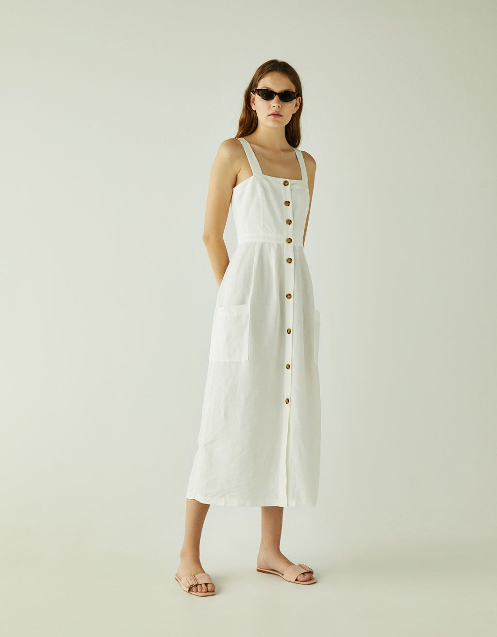 109761fe63e4d0 Linen midi dress with pockets. Discover this and many more items in Bershka  with new products every week