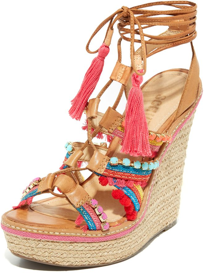 841bc37b8e1 Pom-poms and faceted beads accent the woven straps on these lace-up leather