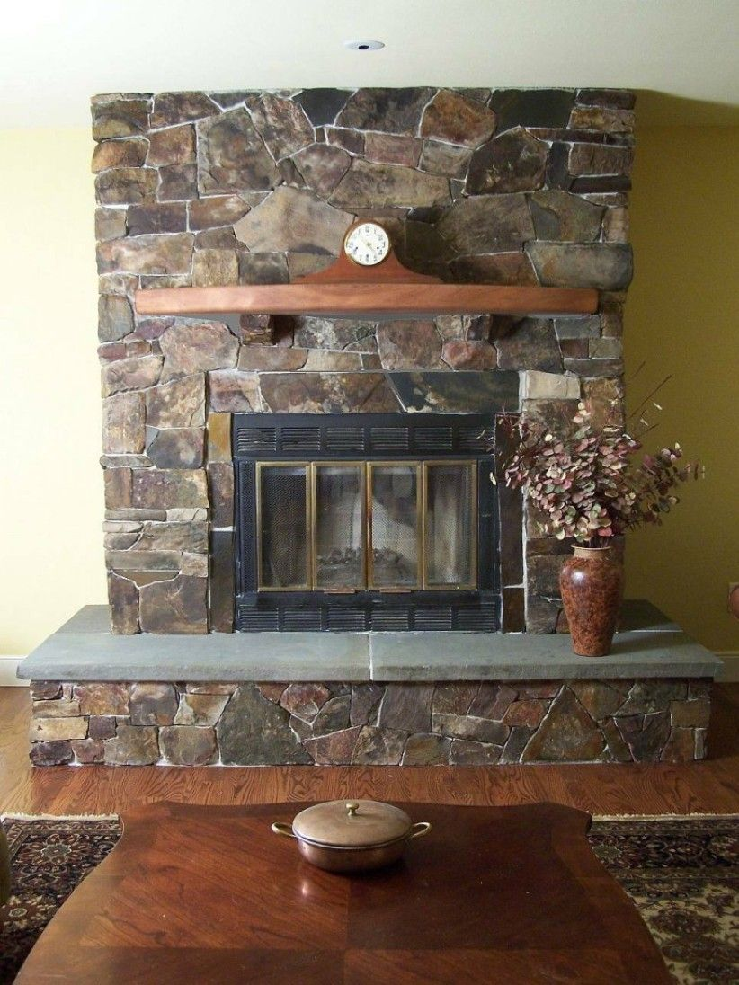 Awesome Stone Fireplace with Wooden Mantel Creating Greater Warmth in Room - http://inesblank.com/awesome-stone-fireplace-with-wooden-mantel-creating-greater-warmth-in-room/