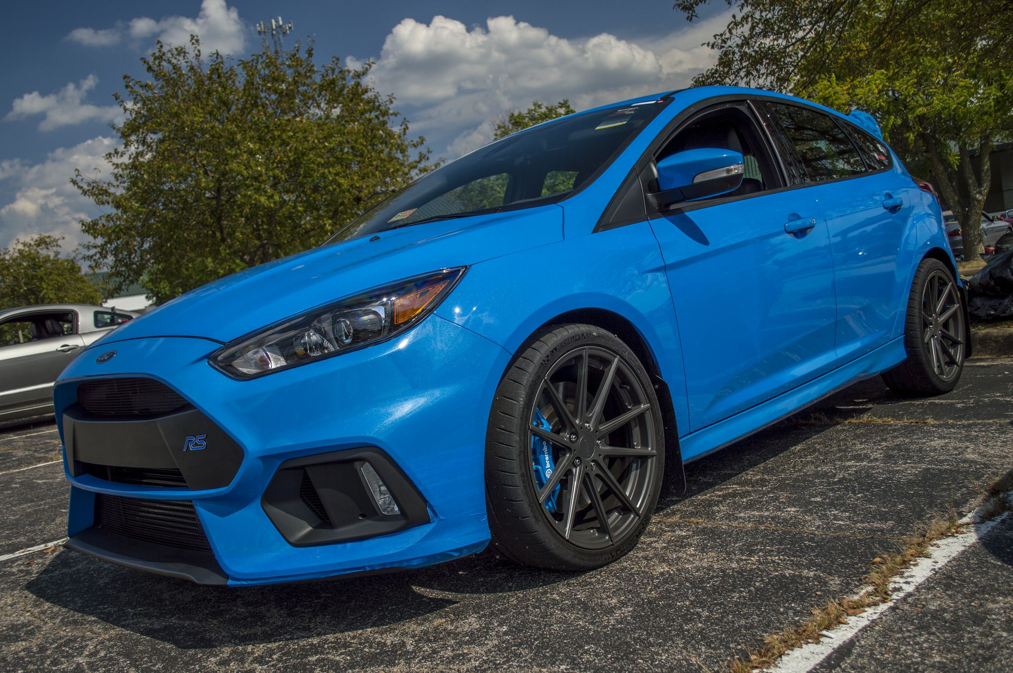 Take A Look At Cj Customer And Autocross Enthusiast Zach S Nitrous Blue Focus Rs Check Out Those Awesome Tsw Alloy Batthurst Whee Tsw Wheels Wheel Autocross