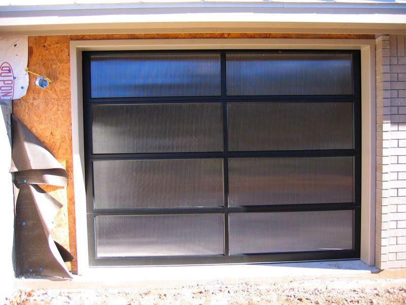 Contemporary Reeded Glass Garage Door Installed At Horseshoe Bay