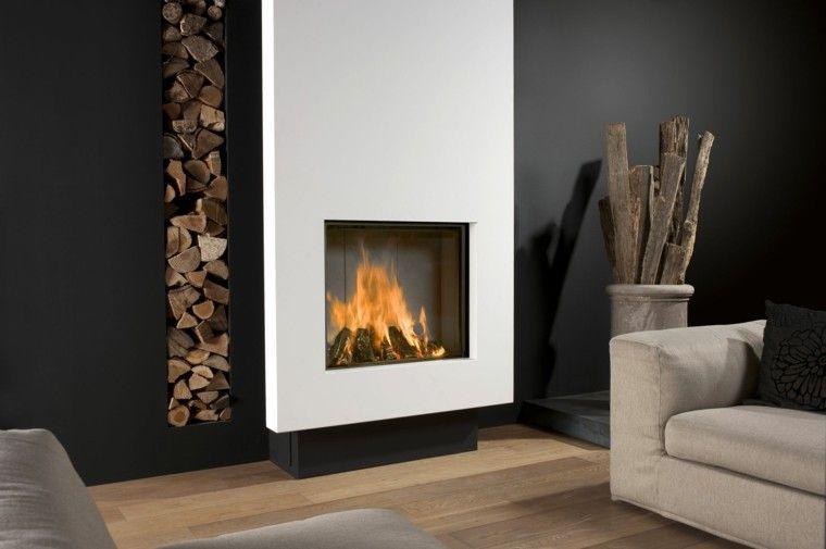 diseño chimeneas modernas troncos apilados sofa Modern fireplaces