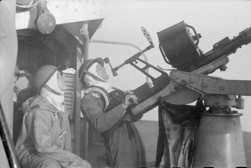 THE ROYAL NAVY DURING THE SECOND WORLD WAR: THE DIEPPE RAID, AUGUST 1942. A 20 mm Oerlikon Mark I gun on board a destroyer in action with enemy aircraft during the Combined Operations daylight raid on Dieppe. Both the crew are wearing anti-flash gear.