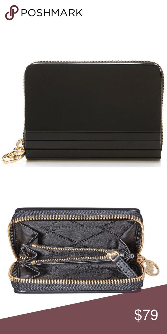 92e806f43e09ee Michael Kors Barbara Zip Around Coin Card Case A ultra-sleek exterior  brings seriously sophisticated