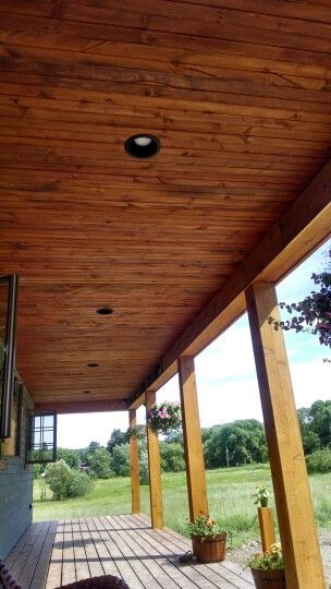 We Stained Our Covered Porch Pine Ceiling Love It Porch Ceiling Patio Flooring Outdoor Porch