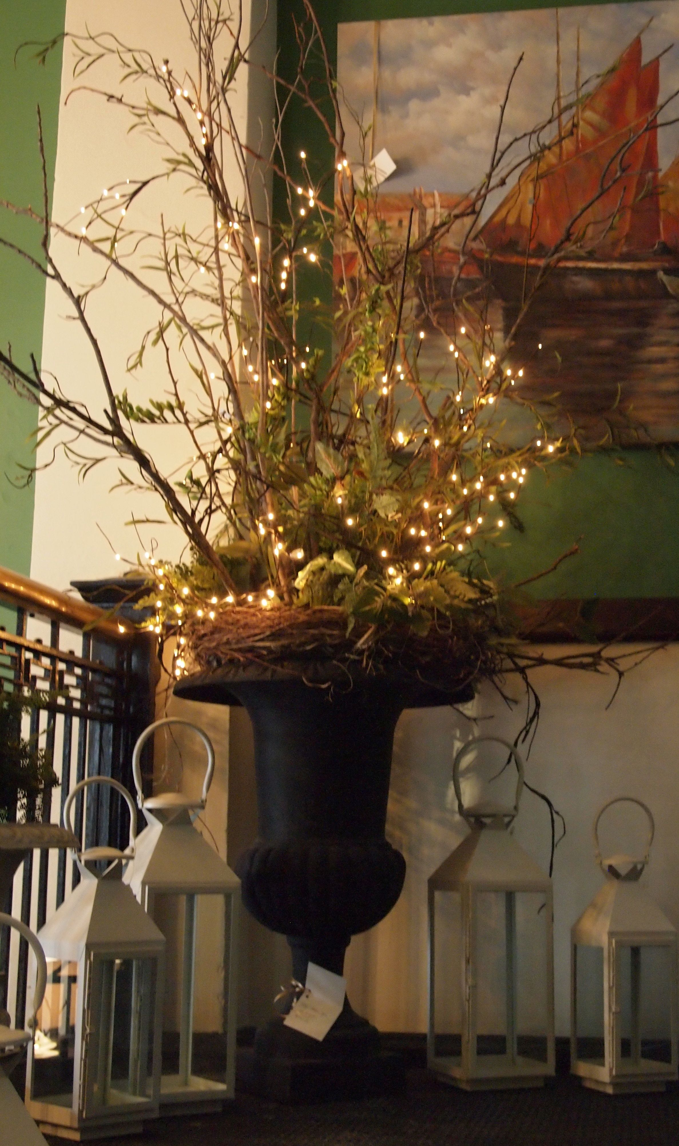 Arrangement Of Real And Faux Branches With White Lights