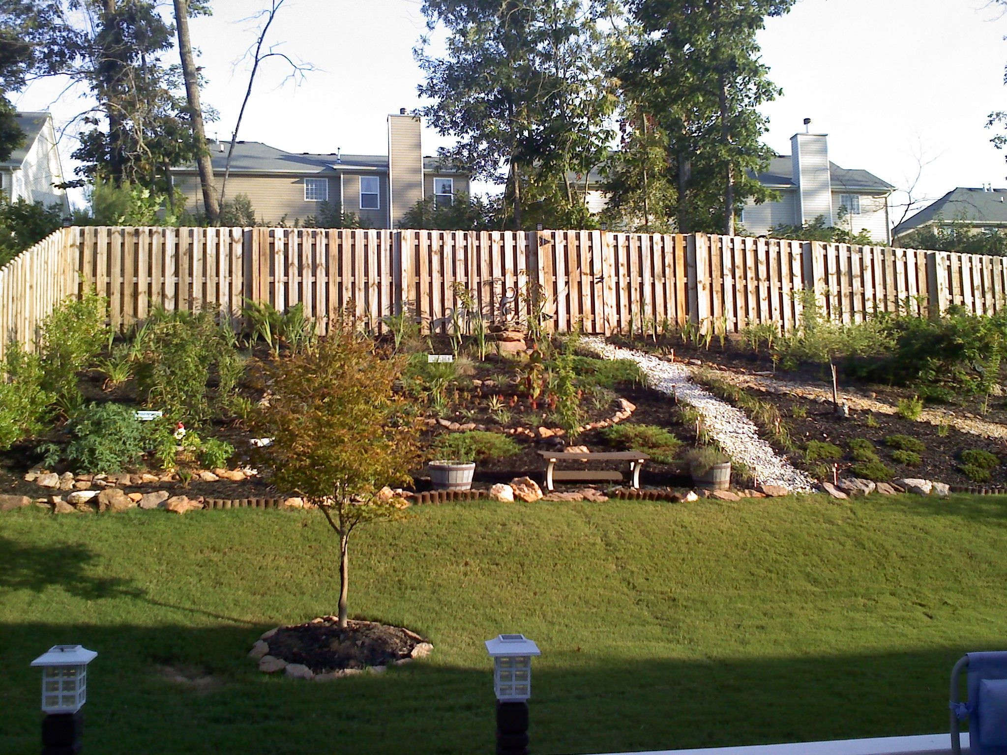 Steep sloped back yard landscaping ideas should we for Pics of landscaped backyards