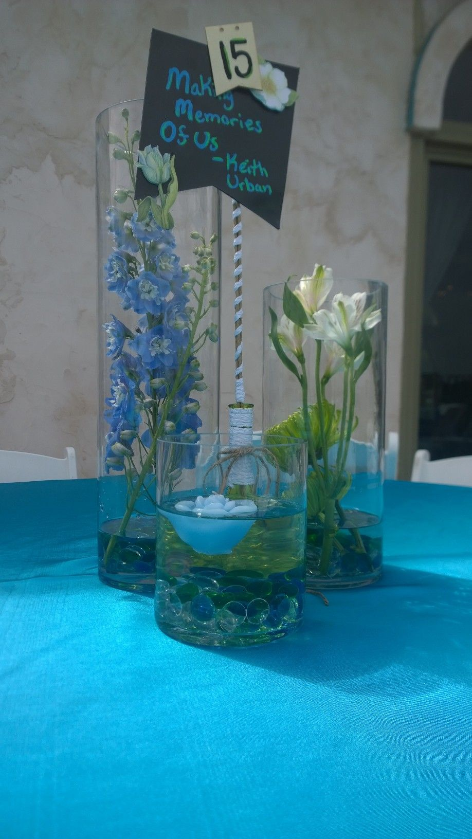 Blue and white cylinder cluster centerpiece