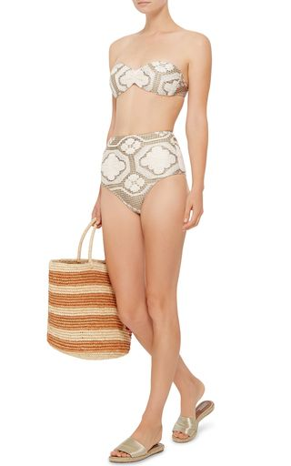 Stylist-turned-designer Liana Thomaz founded the luxury swimwear brand in  Fortaleza, Brazil, over 30 years ago. This **Agua de Coco** bikini top  features a ...