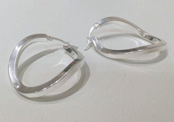 96b612609c17 Argollas ovales torzadas en plata rodinada