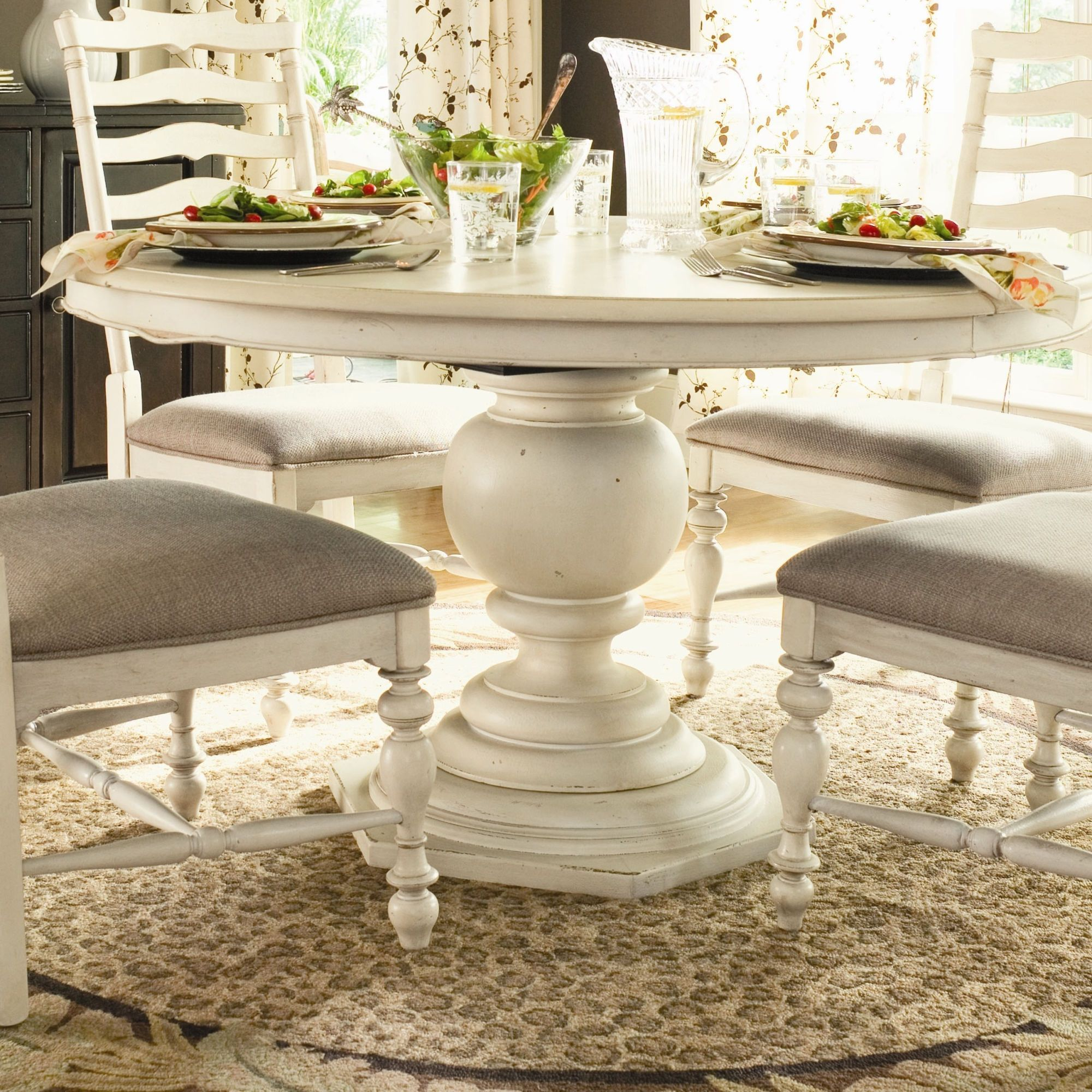 Paula Deen Home Paulas Round Pedestal Dining Table In Linen Chairs Hale Navy With Seat Covers