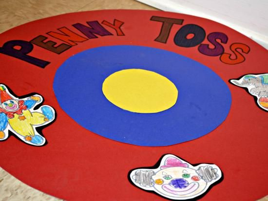 Can toss carnival sign penny toss this was probably Homemade games for adults