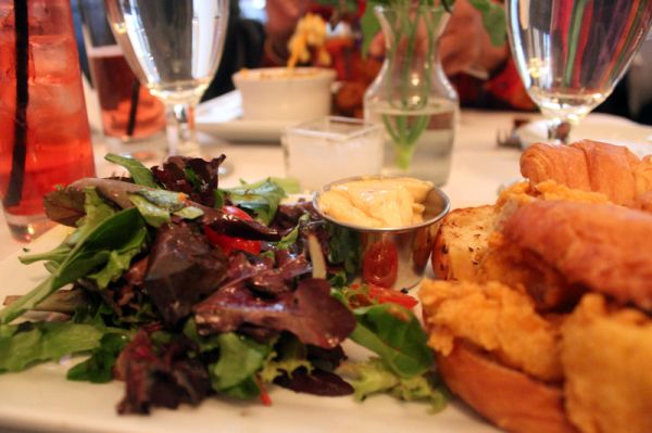 Catfish Po' Boy on a croissant + lemonagrass remoulade + mixed greens salad #foodie #food #dining #NYC