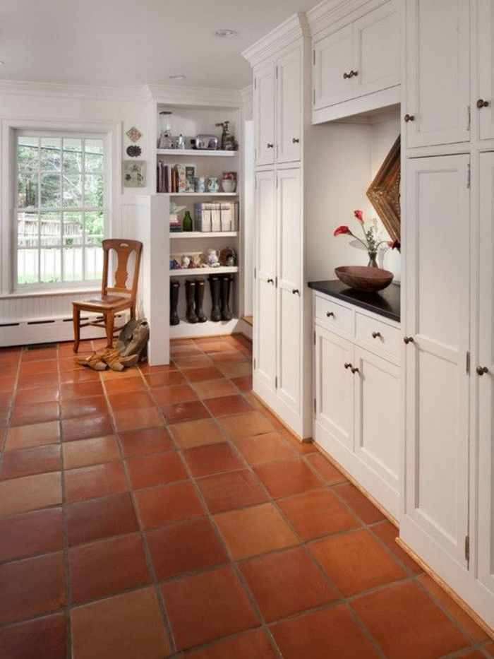 House Interior With White Cabinets And Saltillo Tiles
