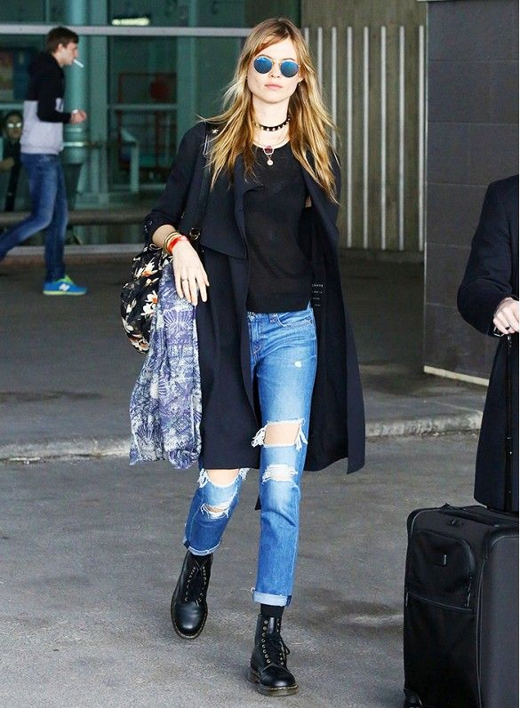 Behati Prinsloo goes a rocker in a choker necklace, mirrored sunglasses and ripped jeans