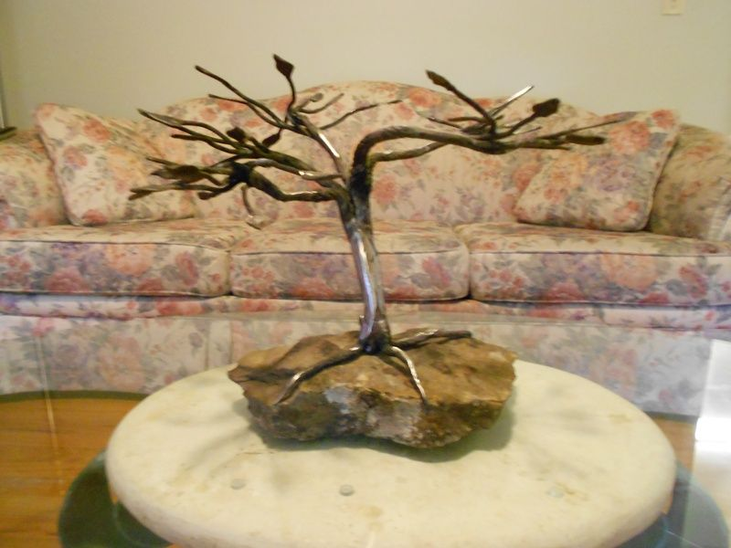 Bonsai tree made from a unique medium, it's forged totally from crane cable.