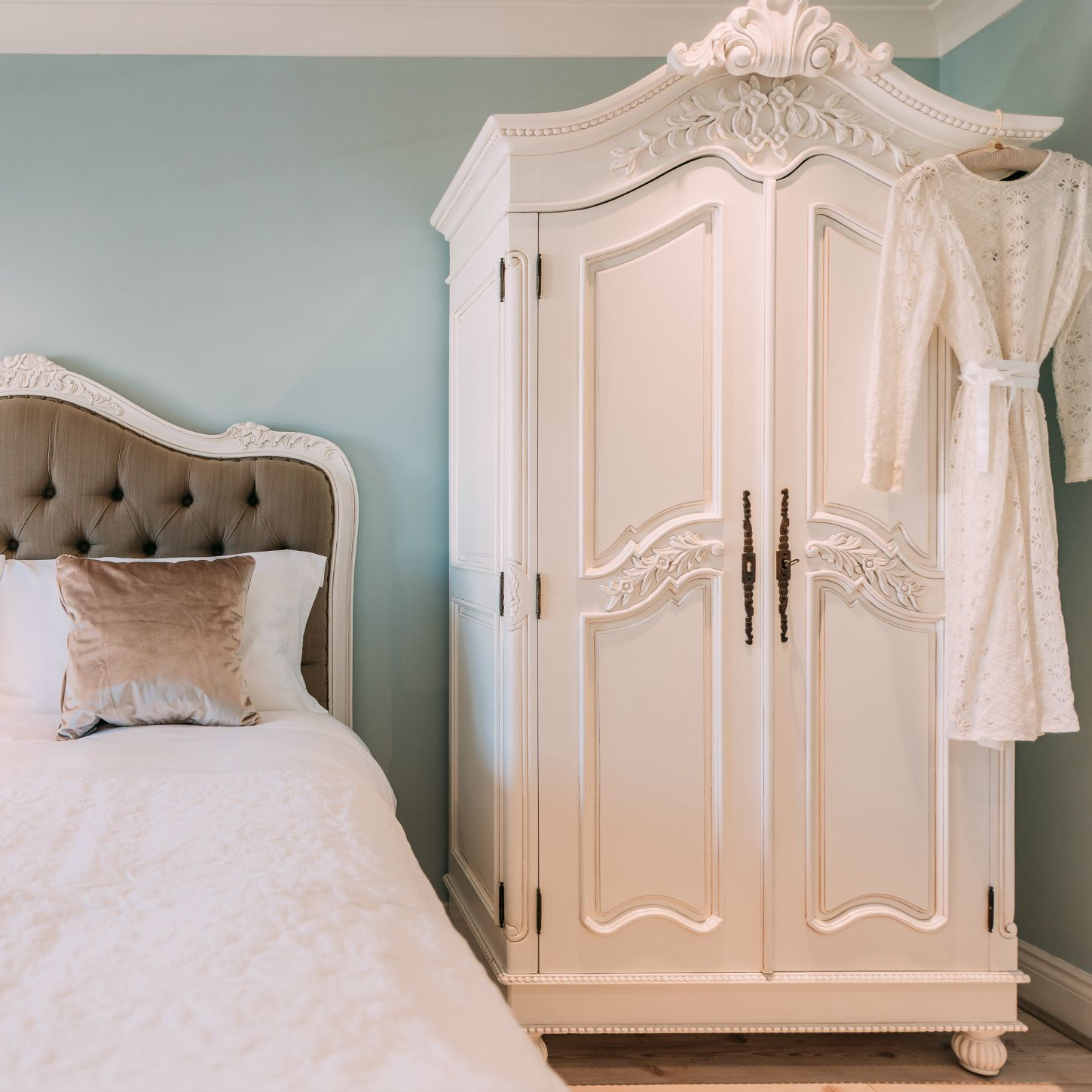 Superbe French White Hand Carved Double Armoire Wardrobe Made From Solid Wood.  Hanging Wooden Rail With