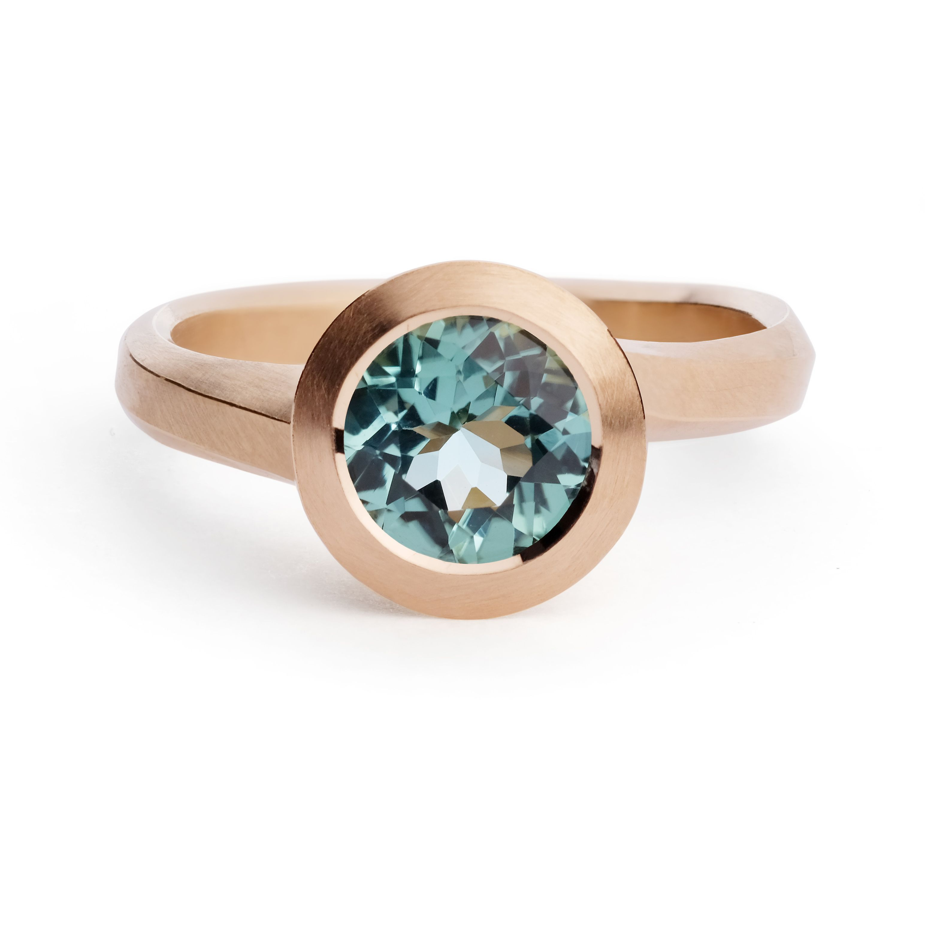 A beautiful shot of one of the latest pieces from our Arris collection featuring a gorgeous seafoam tourmaline. Available in our Exmouth Market atelier or through our website. #seafoamtourmaline #greenbluetourmaline #tourmaline #handcarved #arrisring #rosegold #contemporaryjewellery #alternativeengagementring #jewellerydesign #handcraftedjewellery #handmadelondon #jewelleryatelier #goldsmithing #finejewellery #bespokejewellery #handcarved