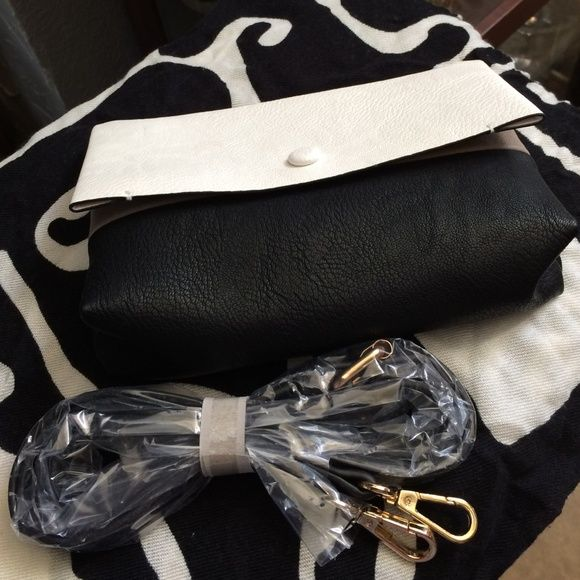 Cute Little White/Black Clutch w-Tan under Flap! Really Fashionable Black/White w-Tan under Flap Clutch! I'm Also selling a Matching Handbag! Has Long Strap! 8 1/2 - 7! Bags Clutches & Wristlets