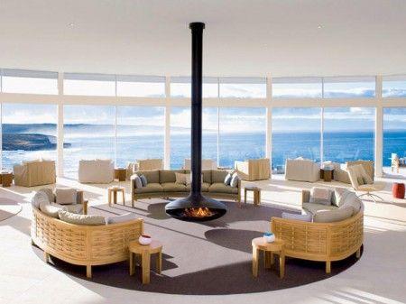 Hogar a le a moderno y con un paisaje asi d chimeneas for Hogares a lena modernos