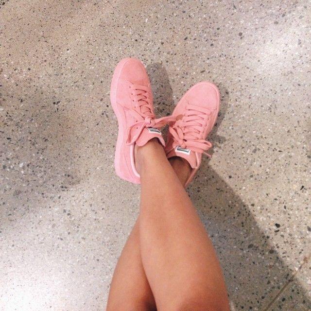 pink suede pumas on feet