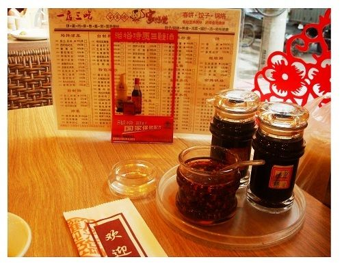 condiments in Chinese restaurant: soy, vinegar, chili oil ...