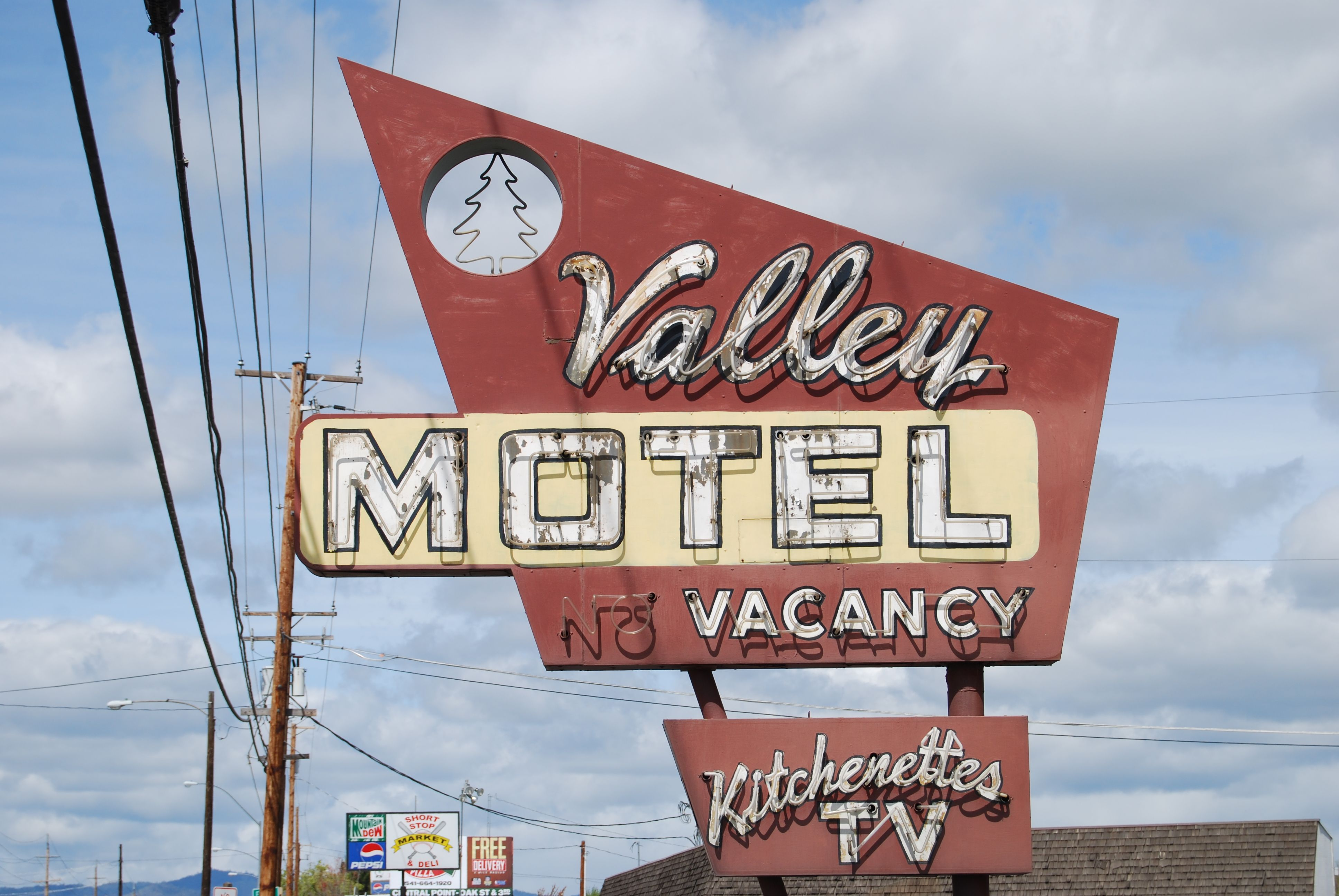 Valley motel and apartments at 3250 n pacific highway in medford oregon note the pine tree in the circular cutout
