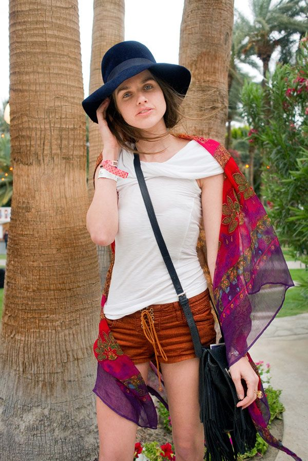 We love her glam take on boho, specifically the boldly-colored sheer scarf and dark navy topper.   - HarpersBAZAAR.com