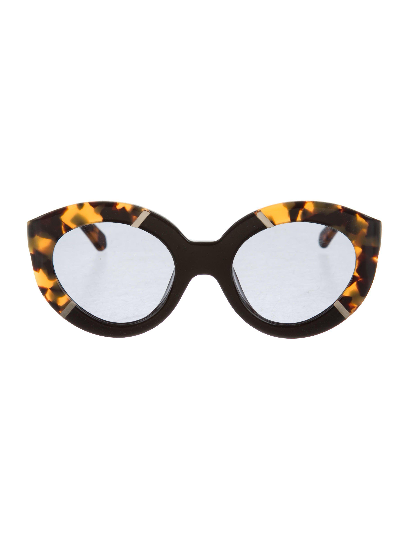 e294d52be3 Tan and black tortoiseshell Karen Walker Flowerpatch oversize sunglasses  with solid black resin trim