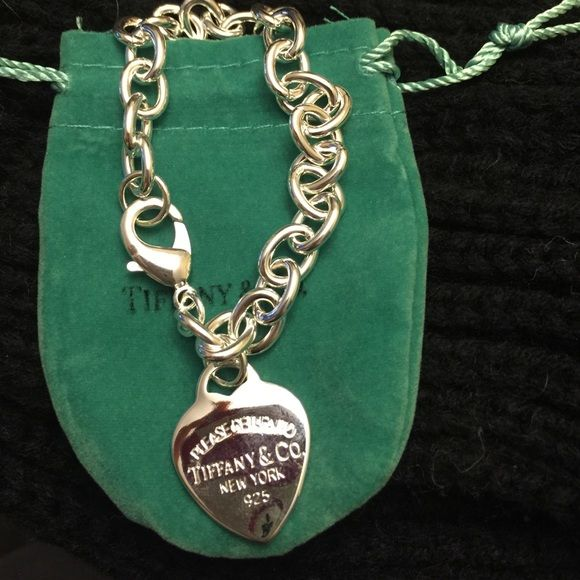 Stamped 925 silver Charm bracelet Silver charm bracelet. Stamped 925. Fits 7 1/2 inch wrist or smaller. NO TRADES! Jewelry Bracelets