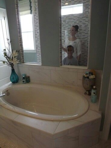 Tub with walk in shower behind
