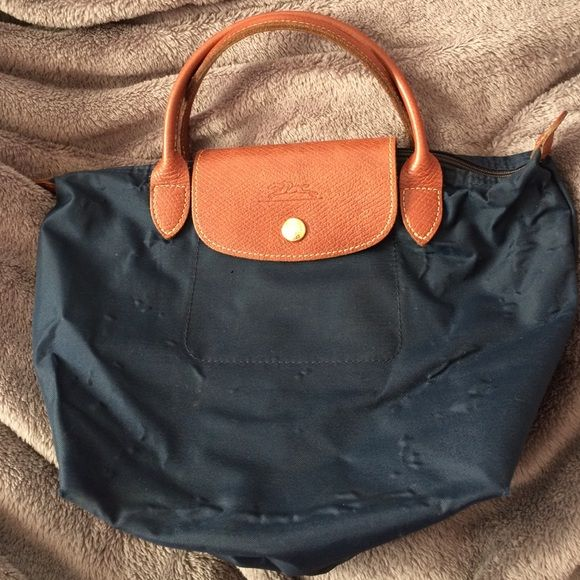 Mini navy  long champ tote Has been used quite a bit. Has bubbling. Longchamp Bags Mini Bags
