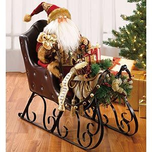 costco santa sitting with gift bag on trimmed sleigh customer
