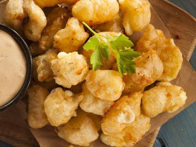 Cheese curds are a great snack or side to serve with a meal. The breading is light and the final product is crispy and golden. They're nearly impossible to stop eating.