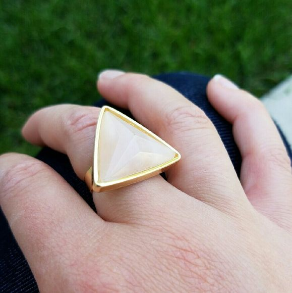 Faceted Semi-Precious Stone Ring Semi-precious stone fashion ring. Peach with gold trim. A semi-precious stone is also known as a gem, which is a mineral in refined and cut form. Fits natural 7 but is adjustable as shown in photo 3. 0.7 inches in diameter. Lead and allergen free Boutique  Jewelry Rings