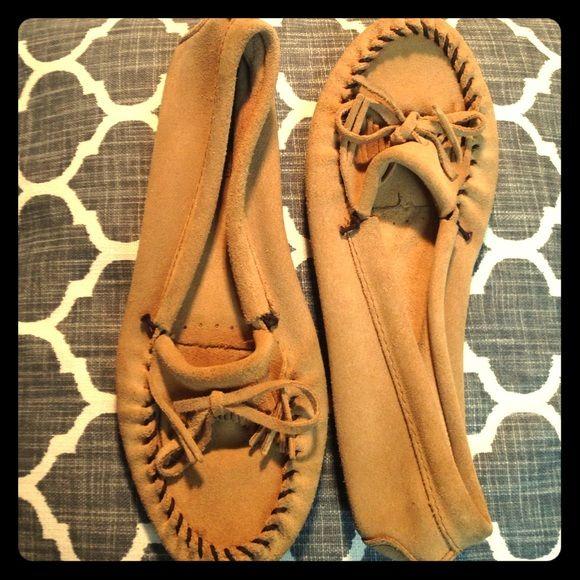 Like new/never worn, genuine Minnetonka moccasins Genuine leather/suede Minnetonka moccasins. Adorable, classic and like new!! Minnetonka Shoes Flats & Loafers