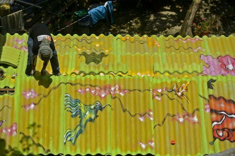 Arte en techos de comuna 13 Medellín