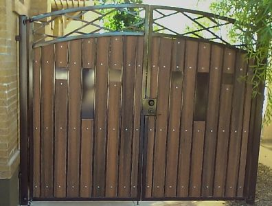 Iron and wood gates design iron and wood gates a for Wooden main gate design