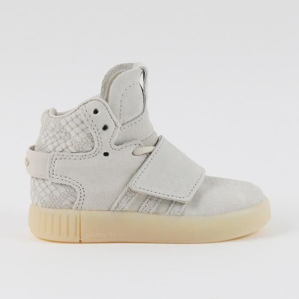 the latest 921ee 6bdb1 DETAILS The Adidas Tubular Invader Strap brings basketball-inspired style  to your little one s tiny feet. Suede and synthetic suede upper Synthetic  lining ...