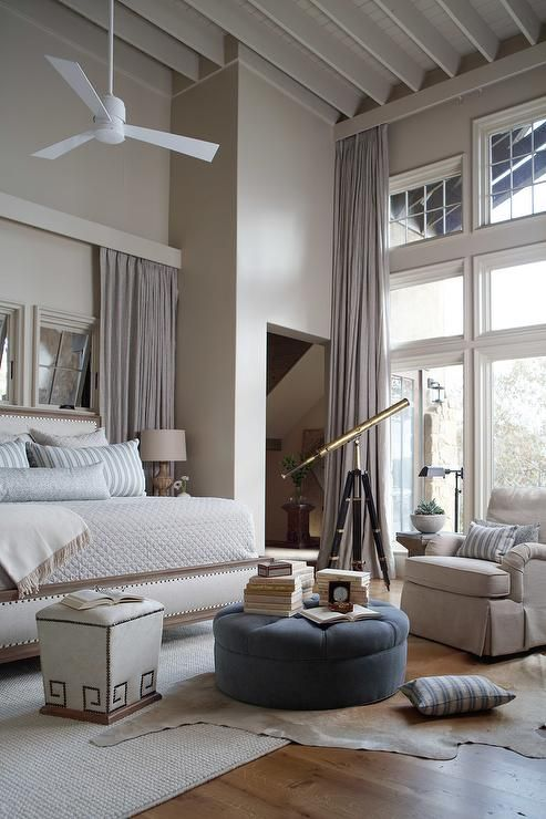 Beautiful Bedroom With High Ceiling Accented With A Ceiling Fan